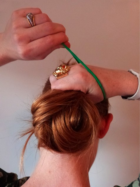 [#UbyKChromageChic Step #5 While still holding the a hair, pull the elastic over it, wrapping it around twice]