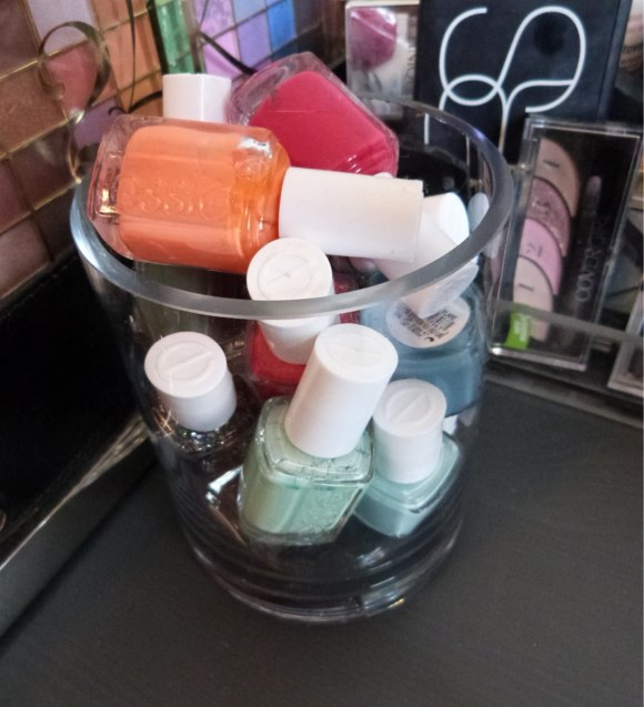 [Some of my favorite nail polishes shades on display in a re-purposed flower vase]